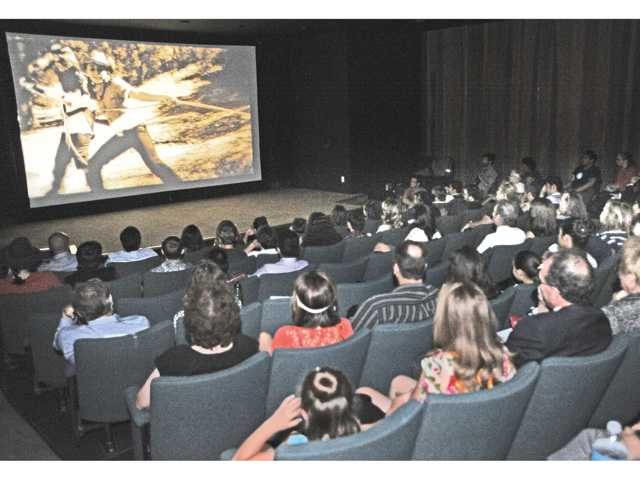 "Student filmmakers, family and friends watch the premiere of ""Quenched"" in the Bijou Theater at California Institute of the Arts in Valencia on Saturday. Photo by Dan Watson"