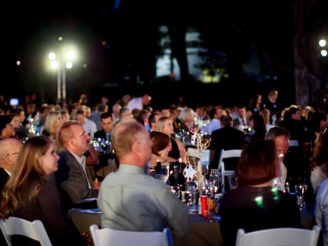 Michael Hoefflin Foundation supporters enjoy the program during the 20th annual Evening Under the Stars gala Saturday.