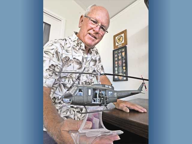 Vietnam veteran Thomas Jones displays  a model of the type of helicopter he flew during the Vietnam war. Photo by Dan Watson.