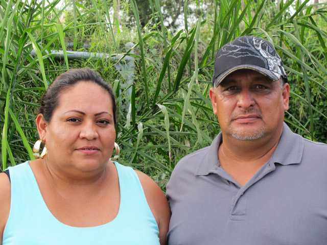 Sigifredo Saldana Iracheta, right, and his wife Laura Saldana pose for a photo outside his sister's home in Brownsville, Texas on Sept. 18.