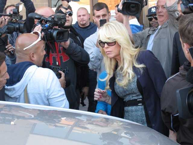 Dina Lohan leaves court in Hempstead, N.Y. on Tuesday after pleading not guilty to drunken driving charges. Police said her blood-alcohol level was 0.20.