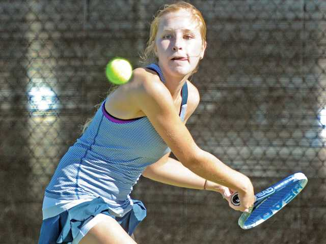 West Ranch singles player Hannah Yuster prepares to hit the ball against Hart on Tuesday at West Ranch High School.