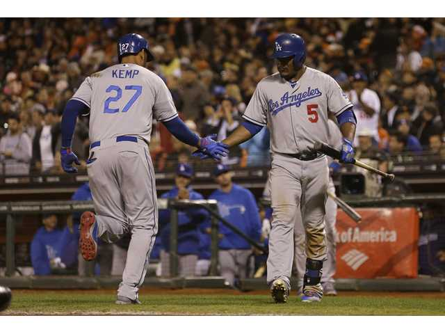 Los Angeles Dodger Matt Kemp (27) is congratulated by Juan Uribe (5) after hitting a solo home run in San Francisco on Tuesday.