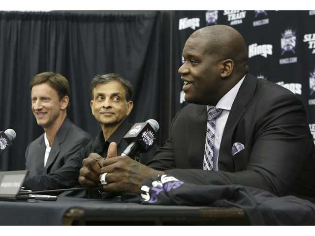 Shaquille O'Neal smiles during a news conference where he was welcomed as one of the new minority owners of the Sacramento Kings in Sacramento on Tuesday.