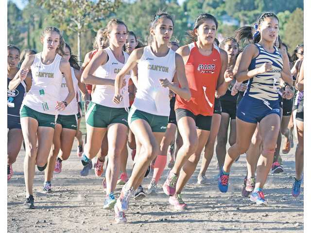 Canyon's Natalie Rodriguez, center, and her teammates begin the girls varsity cross country race at Central park on Thursday.