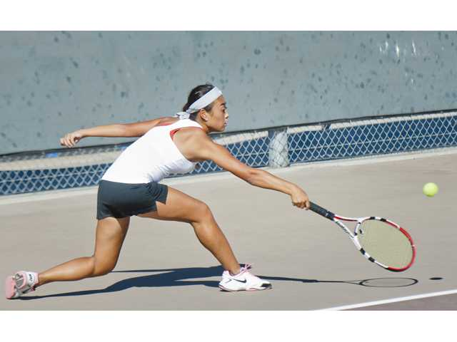 Katelyn Choi of Valencia, returns with a backhand against Beau Lauron of Golden Valley High School, winning her set 6-0 on Thursday.