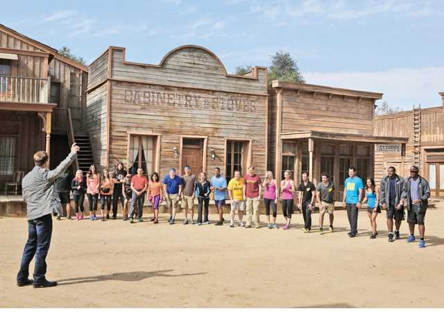 """Amazing Race"" host Phil Keoghan speaks to cast members before the race begins. The reality TV game series' first show of the season was filmed at Newhall's Melody Ranch and airs Sunday evening. Photo courtesy of Trae Patton/CBS"