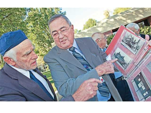 Douglas Gadowski, right, shows the medic tank to Dr. Allen Karz.