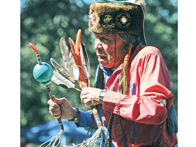 U.S. Marine and Korean War veteran Saginaw Grant of Oklahoma wearing a traditional otter skin headdress, participates in the Gourd Dance during the 20th annual Hart of the West Pow Wow held at William S. Hart Park in Newhall on Saturday. Signal photo by Dan Watson