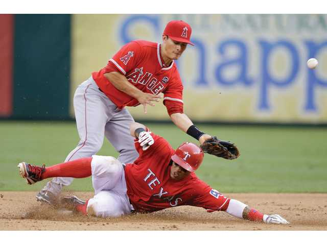 Texas Rangers Leonys Martin, right, steals second base against Los Angeles Angels man Grant Green (10) on Saturday in Arlington, Texas.