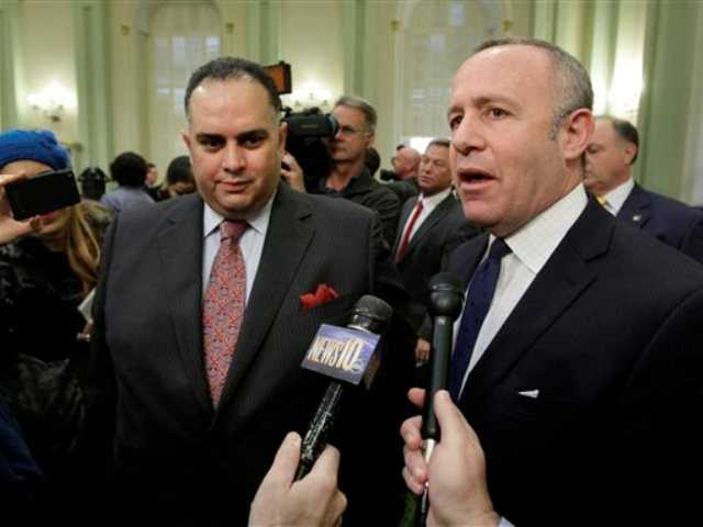 This Jan. 24, 2013 file photo shows Senate President Pro Tem Darrell Steinberg,D-Sacramento, right, and Assembly Speaker John Perez, D-Los Angeles, talking with reporters after Gov. Jerry Brown gave his State of the State address at the Capitol in Sacramento, Calif.