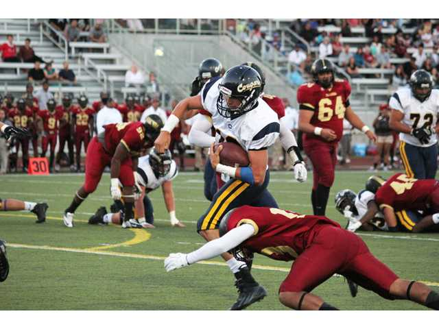 COC quarterback Jake Dashnaw runs against Pasadena. Photo courtesy of Philip Baguiao/ College of the Canyons Sports Information.