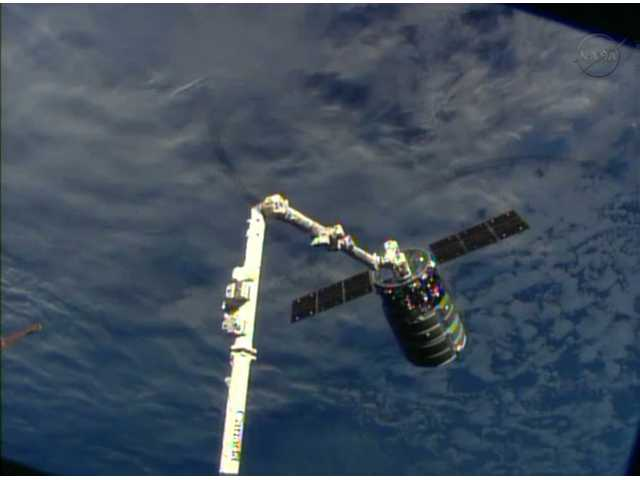This framegrabbed image shows the Cygnus spacecraft attached to the Canadarm 2 on the International Space Station on Sunday.