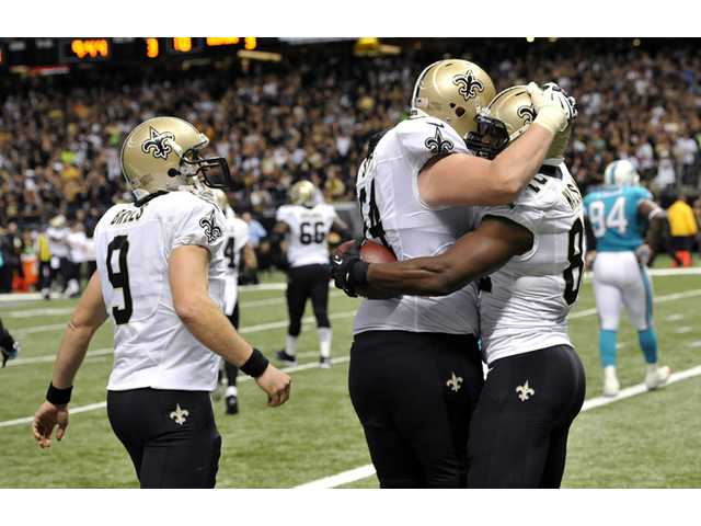 New Orleans Saints tight end Benjamin Watson, right, celebrates his touchdown reception in New Orleans on Monday.