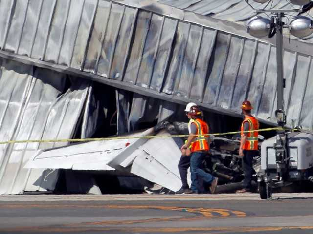 Four bodies were found inside the burned wreckage of a private jet that crashed into a Santa Monica hangar after landing, a coroner's official said Tuesday.
