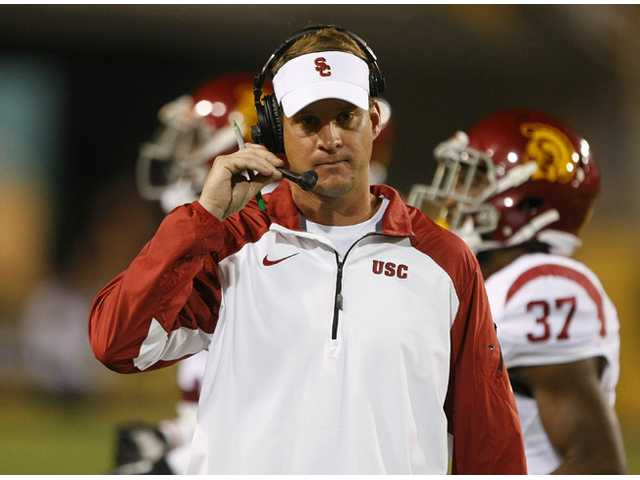 USC coach Lane Kiffin paces on the sideline during a game against Arizona State on Saturday in Tempe, Ariz.