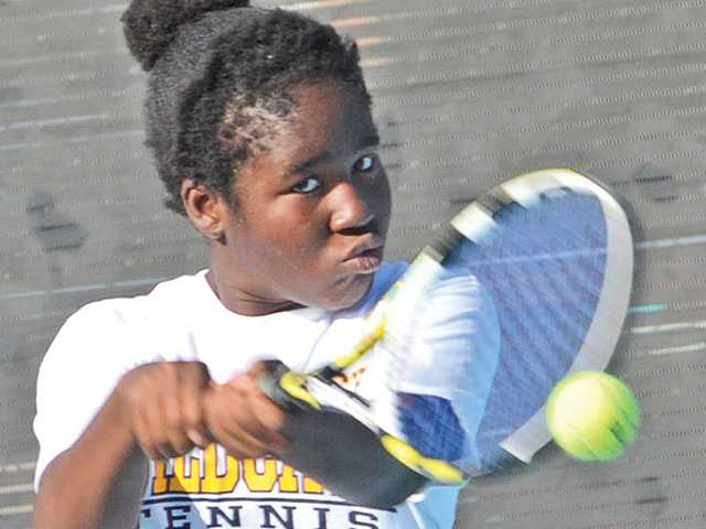 West Ranch freshman singles player Quintera Walter-Eze hits against Saugus at Saugus on Tuesday.