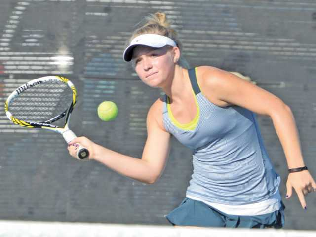 West Ranch singles player Julia Lynch reaches for a ball against Saugus at Saugus High on Tuesday.