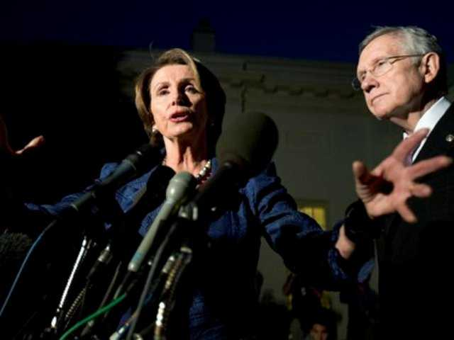 House Minority Leader Rep. Nancy Pelosi, D-Calif., left, with Senate Majority Leader Sen. Harry Reid, D-Nev., speaks to reporters following a meeting with President Barack Obama and the Republican leadership at the White House in Washington, Wednesday, Oct. 2, 2013.