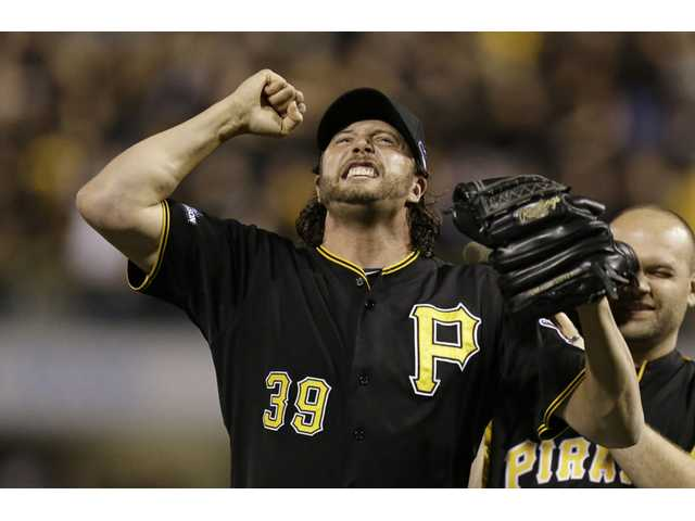 Pittsburgh Pirates relief pitcher Jason Grilli celebrates the Pirates beat the Cincinnati Reds on Tuesday in Pittsburgh. The Pirates won 6-2 and advance to the National League Division Series.