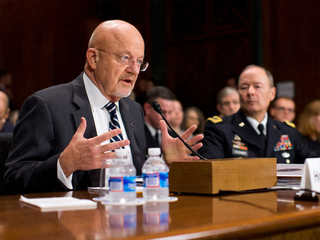 National Intelligence Director James Clapper, left, testifies on Capitol Hill in Washington on Wednesday before the Senate Judiciary Committee oversight hearing on the Foreign Intelligence Surveillance Act.