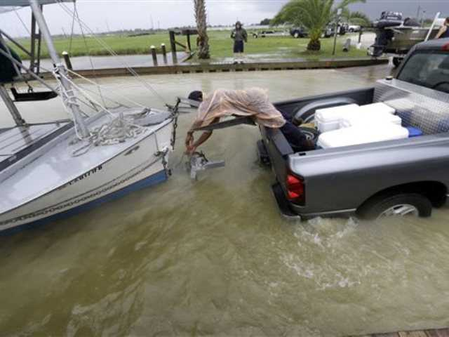 C.J. Johnson pulls a shrimp boat out of the water in preparation for the arrival of Tropical Storm Karen, at Myrtle Grove Marina in Plaquemines Parish, La., Friday, Oct. 4, 2013.