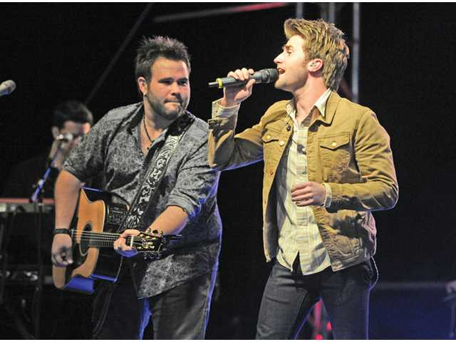 The Swon  Brothers,  Zach, left, and Colton, perform Oklahoma Livin' on stage at the SCV Music Festival held at Valencia Country Club on Friday night. The festival will continue Saturday.