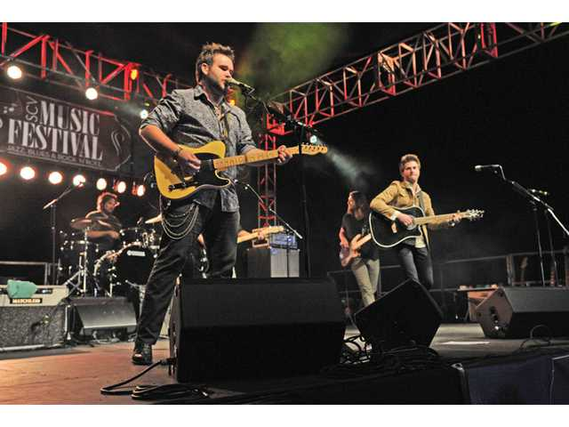 "The Swon Brothers, Zach, left, and Colton, perform ""I Won't Back Down"" on stage at the SCV Music Festival held at Valencia Country Club on Friday night."