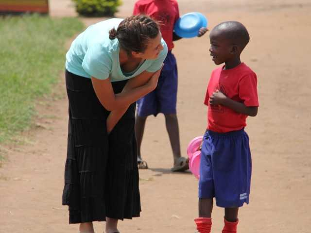 Jacey Massetto stops to talk to a little boy while in Uganda. Courtesy photo