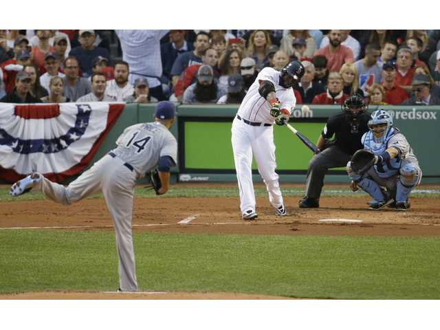 Boston Red Sox's David Ortiz hits a solo home run off Tampa Bay Rays starting pitcher David Price in front of Rays catcher Jose Molina on Saturday in Boston.