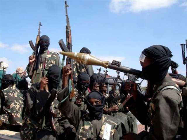 In this Dec. 8, 2008 file photo, armed al-Shabab fighters just outside Mogadishu prepare to travel into the city in pickup trucks after vowing there would be new waves of attacks against Ethiopian troops.