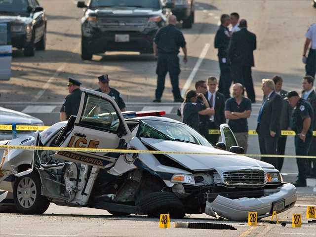 A damaged Capitol Hill police car is surrounded by crime scene tape after a car chase and shooting in Washington, Thursday, Oct. 3. On Thursday, police shot and killed 34-year-old Miriam Carey, of Stamford, Conn., after a car chase that began when Carey tried to breach a barrier at the White House.