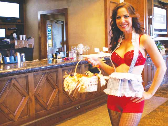 """Soroptimist of Santa Clarita Valley member Deanna Rivetti models the """"Wicked"""" bra auctioned Sunday at the """"Bras of Broadway"""" fundraiser.Photo by Jim Holt."""