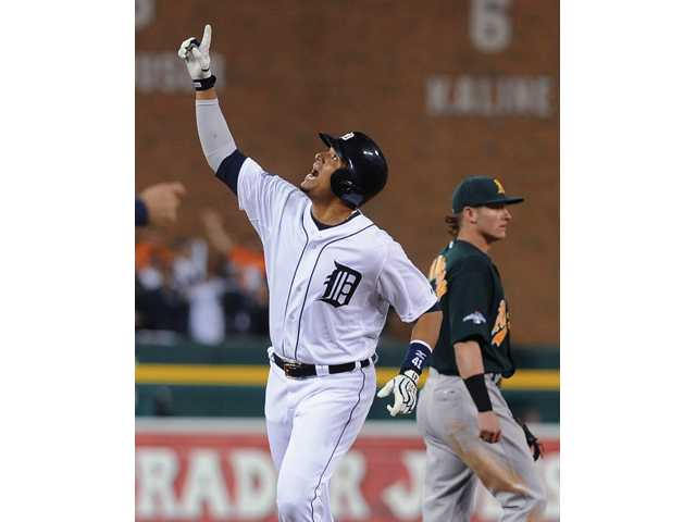Detroit Tigers designated hitter Victor Martinez looks skyward after hitting a home run against the Oakland Athletics in Detroit on Tuesday.