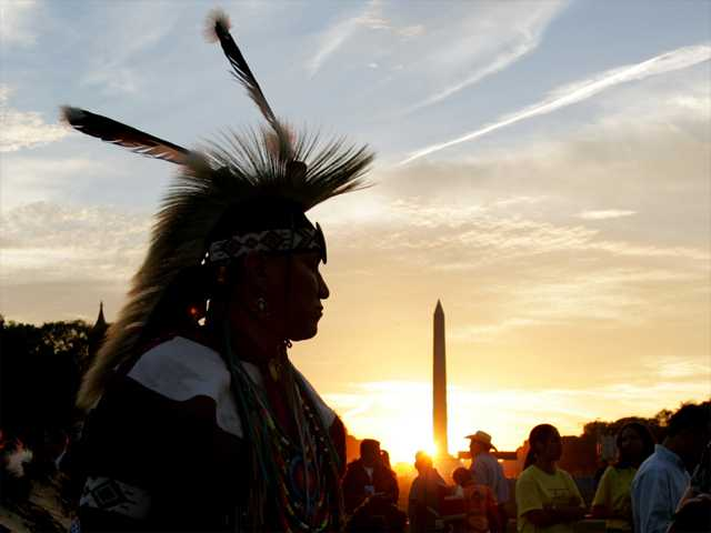 In this Sept. 2004 photo, a member of the Northern Arapaho Tribe who lives on the Wind River Indian Reservation in Wyoming, attends the festivities on the National Mall for the opening of the National Museum of the American Indian in Washington.
