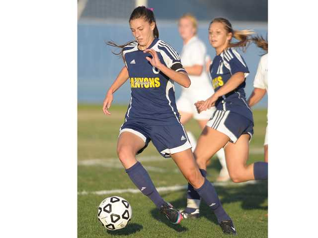 COC's Stacey Atwater, left, charges toward the goal against Bakersfield College at COC on Tuesday.