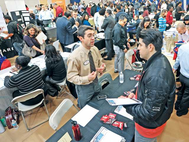 Hundreds of attendees visit the 57 booths offering job and educational information and opportunities at the Job & Career Fair held at College of the Canyons' Valencia campus on Wednesday. Photo by Dan Watson.