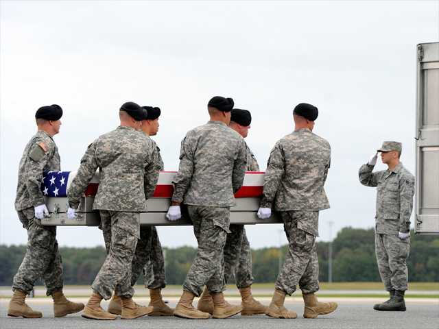 An Army carry team moves a transfer case containing the remains of Pfc. Cody J. Patterson on Wednesday at Dover Air Force Base, Del. According to the Department of Defense, Patterson, 24, of Philomath, Ore., died Oct. 6 in Zhari district, Afghanistan of injuries sustained when enemy forces attacked his unit with an improvised explosive device.