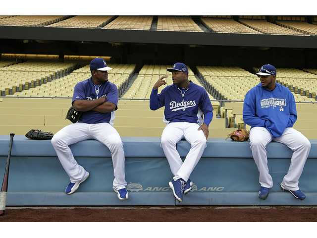 From left to right, Los Angeles Dodgers' Juan Uribe, Carl Crawford and Kenley Jansen talk during practice.