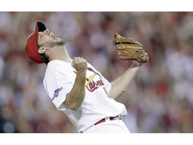 St. Louis Cardinals starting pitcher Adam Wainwright reacts after throwing a complete game during Game 5 of the NLDS.