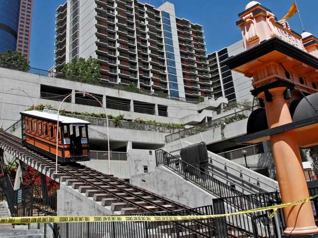Safety officials say operators of the historic Angels Flight railway in downtown L.A. intentionally overrode a safety system before two cars derailed.