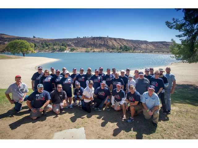 The group of Captains,people who volunteer their boats and time to take children out on the lake to go fishing for the day.   John Chacon, Calif. Dept. of Water Resources