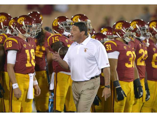 USC interim coach Ed Orgeron talks to his team prior to a game against Arizona on Thursday in Los Angeles.