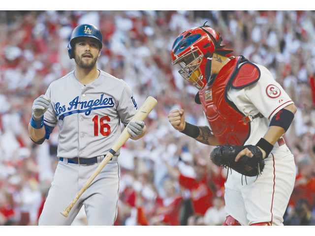 St. Louis Cardinals catcher Yadier Molina pumps his fist after Los Angeles Dodger Andre Ethier struck out on Saturday in St. Louis.