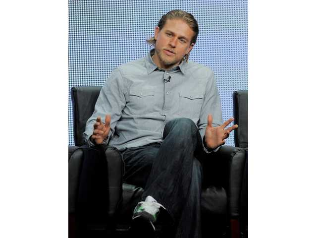 "In this Aug. 2, 2013 file photo, Charlie Hunnam, a cast member in the FX series ""Sons of Anarchy,"" answers a reporter's question during the FX 2013 Summer TCA press tour. Just weeks after being cast as the lead of the high-anticipated big-screen version of ""Fifty Shades of Grey,"" Hunnam is dropping out of the film."