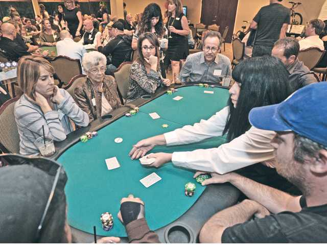 "Attendees at the ""Hold 'Em Not Hassel 'Em Poker Tournament"" to benefit the SCV Youth Project. The fundraising event was held at the Valencia Country Club in Valencia on Saturday night."