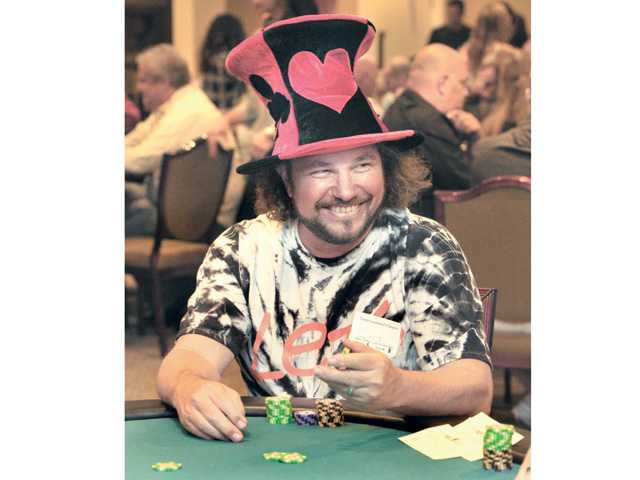 "2012 poker tournament winner Curt Kravitz is waits to be dealt a new hand as he joins dozens of attendees at the ""Hold 'Em Not Hassel 'Em Poker Tournament"" to benefit the SCV Youth Project."