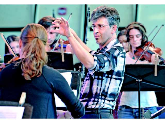 Mark Menzies, center, conducts the music of Antonio Vivaldi as performed by California Institute of the Arts students on Saturday at CalArts.