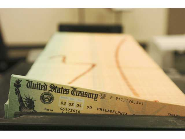 In this 2005 photo, trays of printed social security checks wait to be mailed from the U.S. Treasury's Financial Management services facility in Philadelphia.