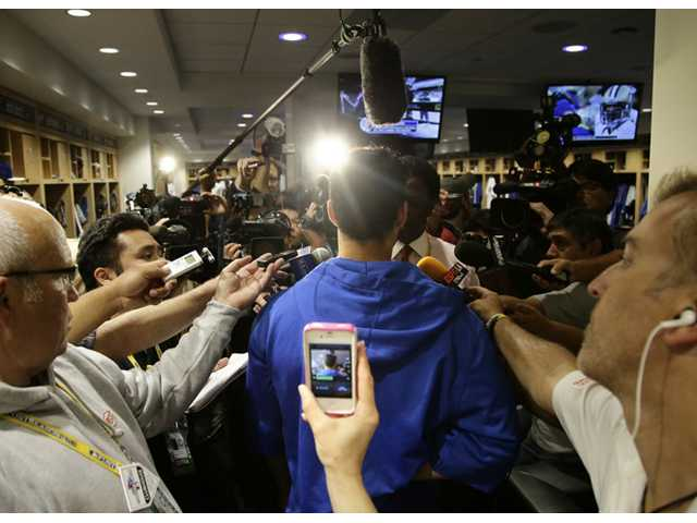 Los Angeles Dodgers' Andre Ethier, center, talks to reporters in the clubhouse after practice in preparation for today's Game 3.
